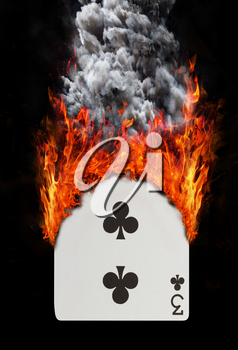 Playing card with fire and smoke, isolated on white - Three of clubs