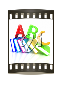 alphabet on a colorful real books on white background. The film strip
