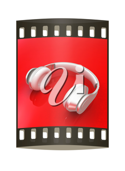 White headphones isolated on a red background. The film strip