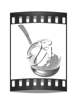 Blue earth on gold soup ladle on a white background. The film strip