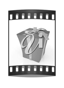 Red gift with gold ribbon on a white background. The film strip