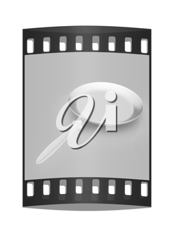 Pan with handle on light gray background. The film strip