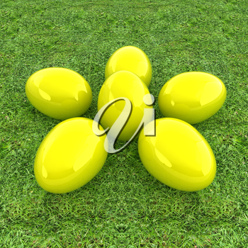Yellow Easter eggs as a flower on a green grass