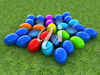 Colored Easter eggs as a flower on a green grass