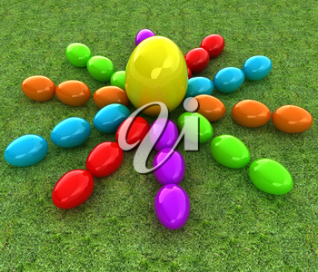 Colored Easter eggs as a flower and Big Easter Egg in the centre on a green grass