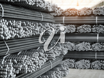Reinforcement bars stacks. Metal products in metallurgical plant or warehouse. Industriall concept. 3d illustration