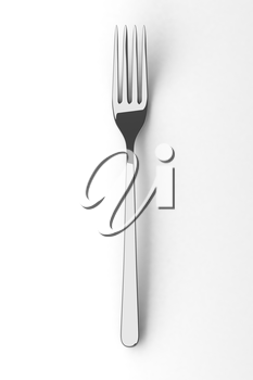 Silver spoon on a table. Fine cutlery on white background. Single fork on a table. Silverware with shadow. 3D illustration.