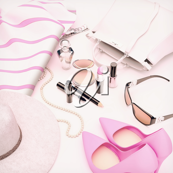 Set of cosmetics and various accessories for women on a white background.