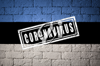 Flag of the Estonia with original proportions. stamped of Coronavirus. brick wall texture. Corona virus concept. On the verge of a COVID-19 or 2019-nCoV Pandemic.