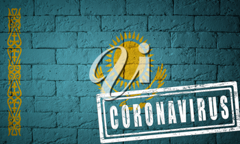 Flag of the Kazakhstan with original proportions. stamped of Coronavirus. brick wall texture. Corona virus concept. On the verge of a COVID-19 or 2019-nCoV Pandemic.