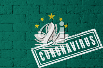 Flag of the Makau with original proportions. stamped of Coronavirus. brick wall texture. Corona virus concept. On the verge of a COVID-19 or 2019-nCoV Pandemic.