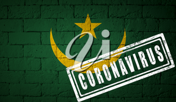 Flag of the Mauritania on brick wall texture. stamped of Coronavirus. Corona virus concept. On the verge of a COVID-19 or 2019-nCoV Pandemic. Novel Chinese Coronavirus outbreak