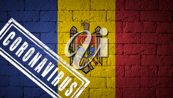 Flag of the Moldova with original proportions. stamped of Coronavirus. brick wall texture. Corona virus concept. On the verge of a COVID-19 or 2019-nCoV Pandemic.