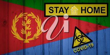Flag of the Eritrea in original proportions. Quarantine and isolation - Stay at home. flag with biohazard symbol and inscription COVID-19.