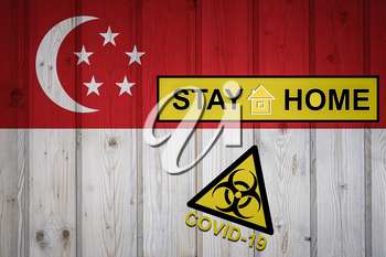 Flag of the Singapore in original proportions. Quarantine and isolation - Stay at home. flag with biohazard symbol and inscription COVID-19.