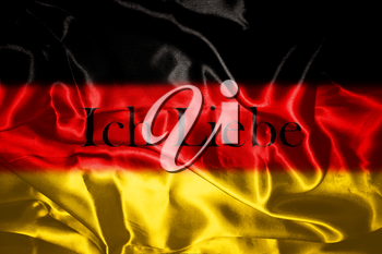 German flag blowing in the wind With Letters That Spell I Love